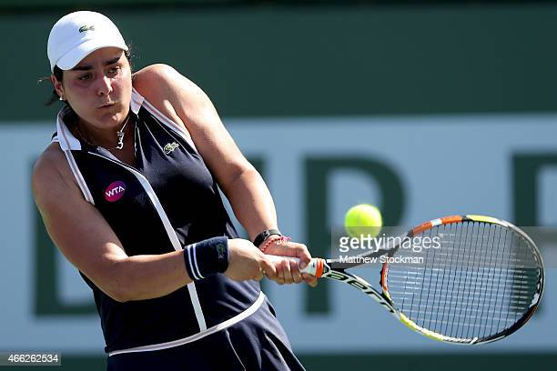 Ons Jabeur of Tunisia returns a shot to Caroline Wozniacki of Denmark during day six of the BNP Paribas Open at the Indian Wells Tennis Garden on...