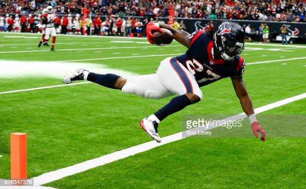 Onta Foreman of the Houston Texans runs 34 yards for a touchdown in the fourth quarter against the Arizona Cardinals at NRG Stadium on November 19...