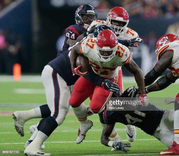 Onta Foreman of the Houston Texans runs between Christian Covington of the Houston Texans and Zach Cunningham in the second quarter at NRG Stadium on...