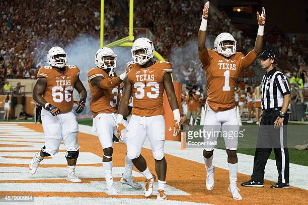 Onta Foreman of the Texas Longhorns celebrates with teammates after scoring a touchdown on a twoyard run against the Rice Owls during the third...