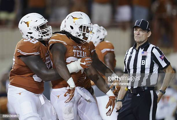 Onta Foreman of the Texas Longhorns celebrates with teammates after scoring a 19yard rushing touchdown during the fourth quarter against the Notre...