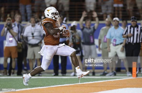 Onta Foreman of the Texas Longhorns scores a 19yard rushing touchdown during the fourth quarter against the Notre Dame Fighting Irish at Darrell K...