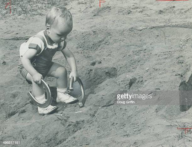 Ontario holiday Lake of Bays He may not score many ringers but this youngsters is learning early the delights of horseshoe pitching The Lake of Bays...