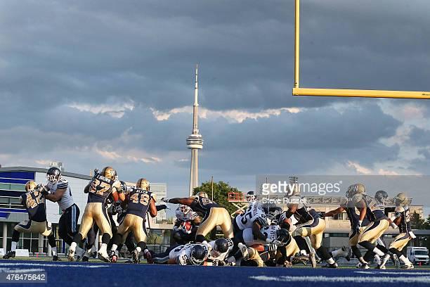TORONTO Ontario JUNE 9 Toronto Argonauts running back Lyle McCombs runs for a touchdown as the Toronto Argonauts play the Winnipeg Blue Bombers as...