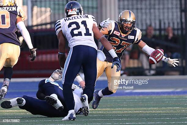 TORONTO Ontario JUNE 9 Winnipeg Blue Bombers safety Teague Sherman tracks down a fumble as the Toronto Argonauts play the Winnipeg Blue Bombers as...