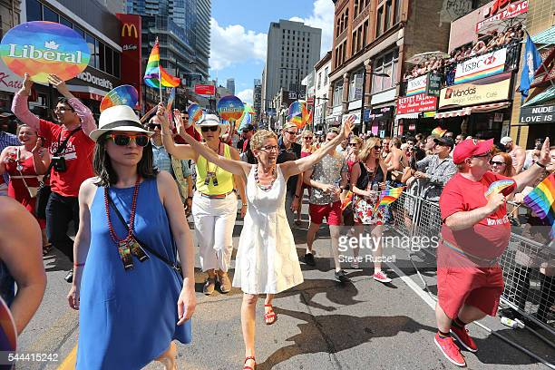 TORONTO ON JULY 3 Ontario Premier Kathleen Wynne during the the 2016 Toronto Pride parade along Yonge Street in Toronto July 3 2016
