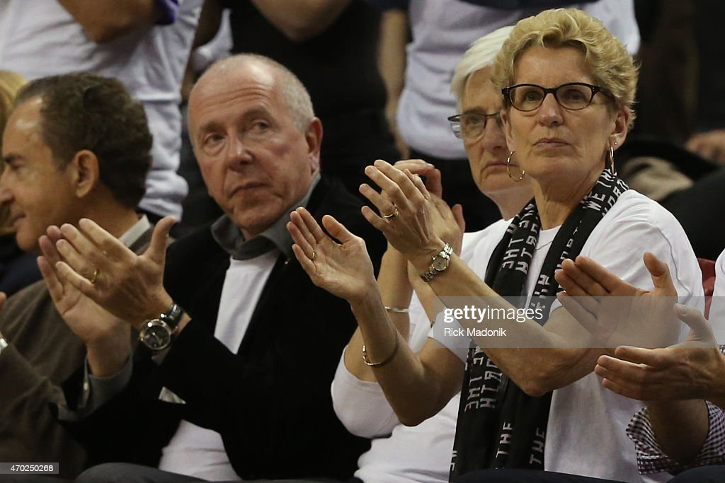 TORONTO - APRIL 18 - Ontario Premier <a gi-track='captionPersonalityLinkClicked' href=/galleries/search?phrase=Kathleen+Wynne&family=editorial&specificpeople=10626599 ng-click='$event.stopPropagation()'>Kathleen Wynne</a> in the front row with MLSE Chairman <a gi-track='captionPersonalityLinkClicked' href=/galleries/search?phrase=Larry+Tanenbaum&family=editorial&specificpeople=695587 ng-click='$event.stopPropagation()'>Larry Tanenbaum</a>. Toronto Raptors vs Washington Wizzards during 2nd half action at the Air Canada Centre of the 1st round of NBA playoffs on April 18, 2015. Raptors lose 93-86.
