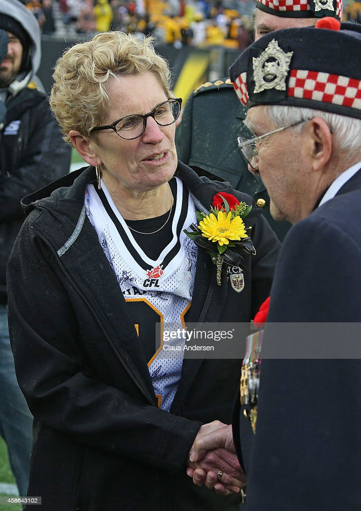 Ontario premier <a gi-track='captionPersonalityLinkClicked' href=/galleries/search?phrase=Kathleen+Wynne&family=editorial&specificpeople=10626599 ng-click='$event.stopPropagation()'>Kathleen Wynne</a> shakes hands with a veteran prior to play between the Montreal Alouettes and the Hamilton Tiger-cats in a CFL football game at Tim Hortons Field on November 8, 2014 in Hamilton, Ontario, Canada.