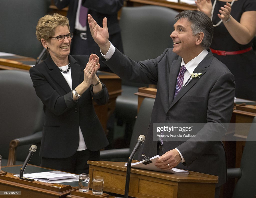 Ontario Premier Kathleen Wynne with Finance Minister Charles Sousa tabled the $127.6-billion spending plan Thursday, making official what he had been telegraphing for days.