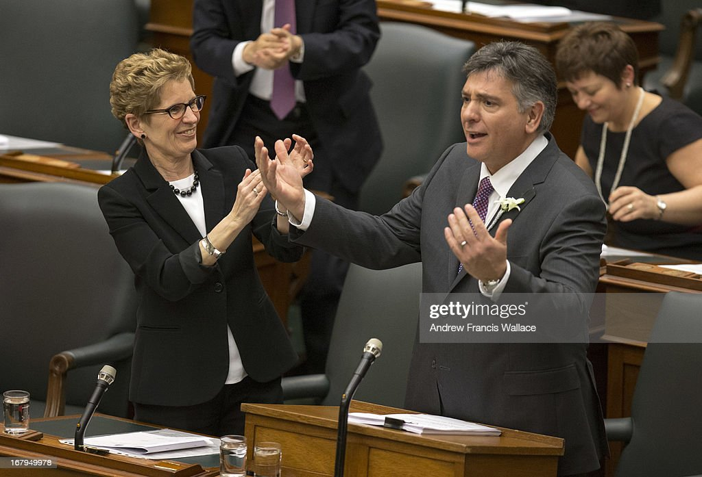 Ontario Premier Kathleen Wynne (L) with Finance Minister Charles Sousa tabled the $127.6-billion spending plan Thursday, making official what he had been telegraphing for days.