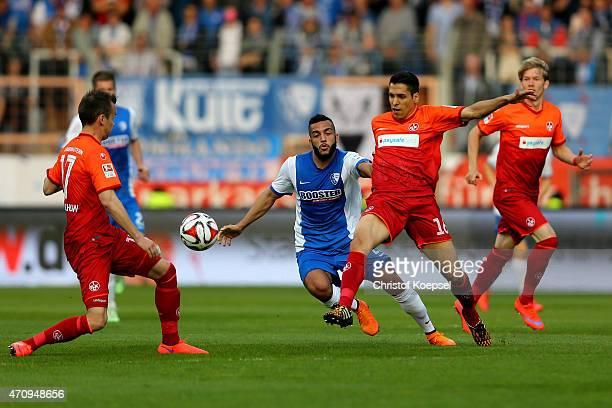 Onur Bulut of Bochum challenges Karim Matmour of Kaiserslautern during the Second Bundesliga match between VfL Bochum and 1 FC Kaiserslautern at...