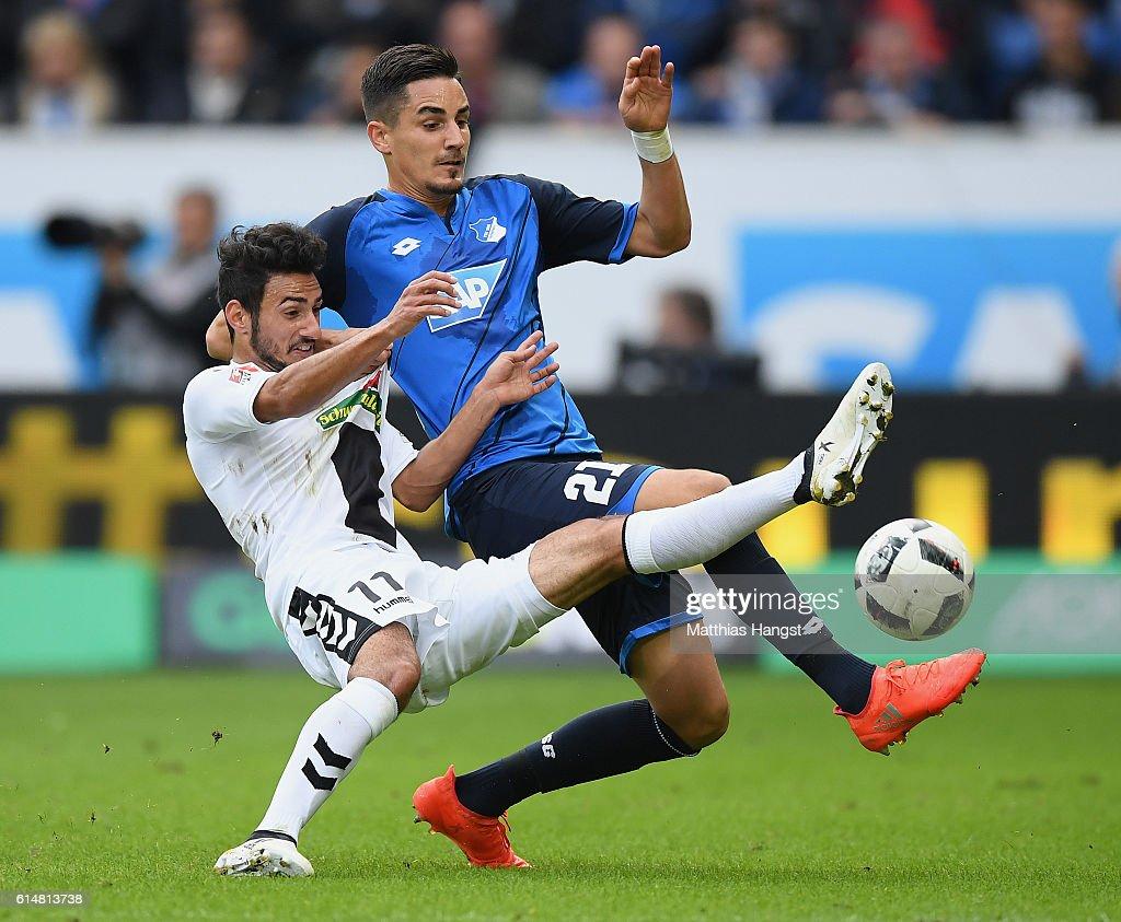 Onur Bulut of Freiburg and Benjamin Huebner of Hoffenheim compete for the ball during the Bundesliga match between TSG 1899 Hoffenheim and SC Freiburg at Wirsol Rhein-Neckar-Arena on October 15, 2016 in Sinsheim, Germany.