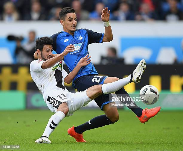 Onur Bulut of Freiburg and Benjamin Huebner of Hoffenheim compete for the ball during the Bundesliga match between TSG 1899 Hoffenheim and SC...