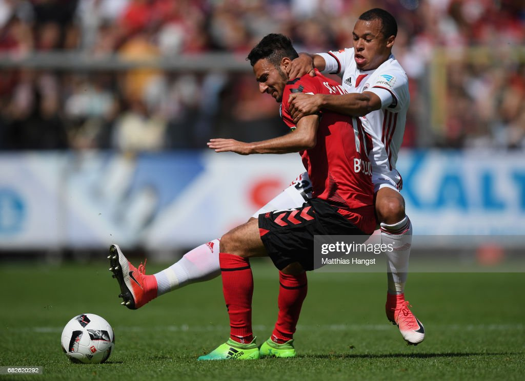 Onur Bulut of Freiburg is challenged by Marcel Tisserand of Ingolstadt during the Bundesliga match between SC Freiburg and FC Ingolstadt 04 at Schwarzwald-Stadion on May 13, 2017 in Freiburg im Breisgau, Germany.