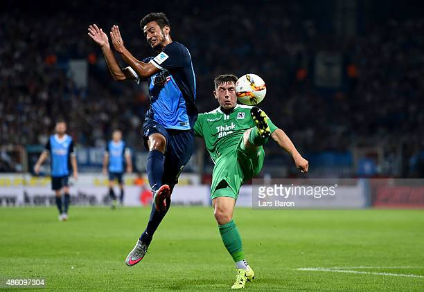 Onur Bulut of VfL Bochum challenges Maximilian Wittek of TSV 1860 Muenchen during the Second Bundesliga match between VfL Bochum and 1860 Muenchen at...