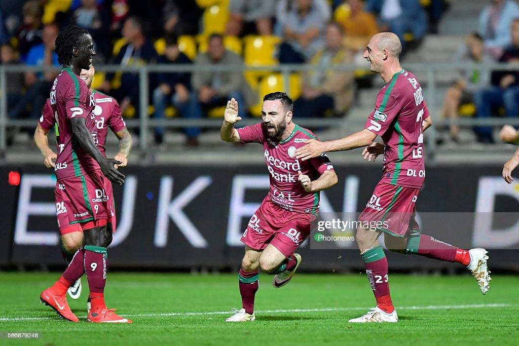 Onur Kaya midfielder of SV Zulte Waregem celebrates scoring a goal in between Mbaye Leye forward of SV Zulte Waregem and Christophe Lepoint...