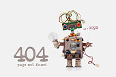 Oops 404 error page not found. Futuristic robot concept with electrical wire hairstyle. Circuits socket chip toy mechanism, funny head, colored eyes, light bulb in hand. beige background