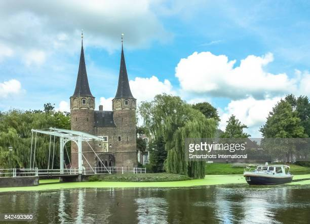 Oostpoort (Eastern Gate), a medieval dam gate with typical small white drawbridge in Delft, the Netherlands