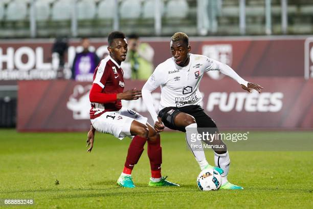 Opa N'guette of Metz and Yann Karamoh of Caen during the Ligue 1 match between Fc Metz and SM Caen at Stade SaintSymphorien on April 15 2017 in Metz...