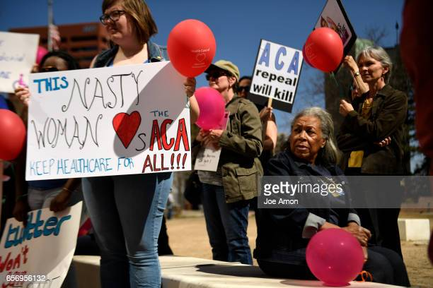 Opal Bruner listens during a protest on the 7th anniversary of the Affordable Care Act being signed into law 'I'm supporting something I believe in'...