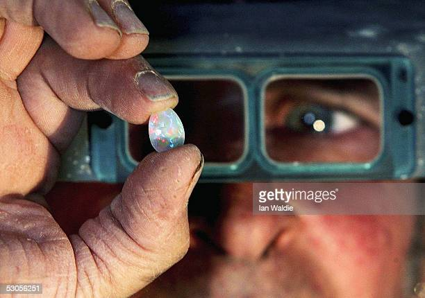 Opal miner John Shane holds a finished opal June 12 2005 in the outback mining town of Coober Pedy Australia Australia supplies 95 percent of the...