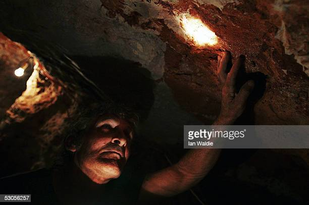 Opal miner John Shane inspects a rock face his underground mine June 12 2005 in the outback mining town of Coober Pedy Australia Australia supplies...