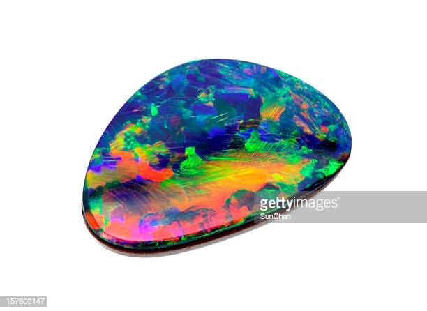Opal rock with many colors isolated on white