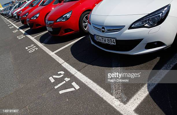 Opel Astra vehicles of carmaker Adam Opel GmbH are parked outside the production plant on July 24 2012 in Ruesselsheim Germany Opel CEO KarlFriedrich...
