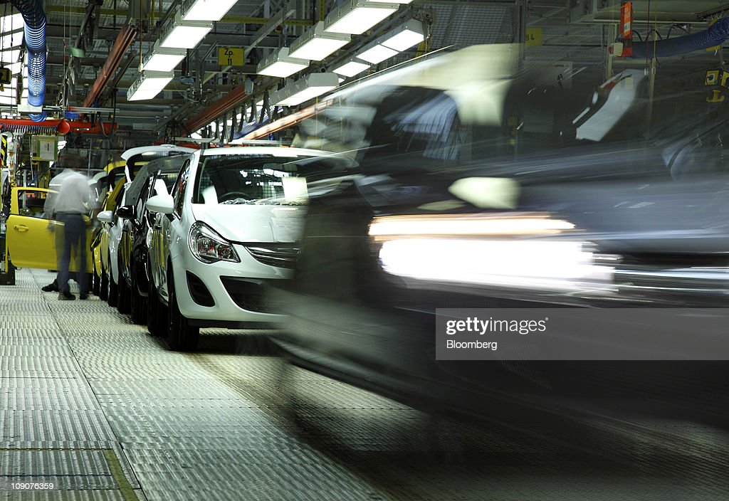 Opel Corsa automobiles pass along the production line at the General Motor Co.'s Adam Opel plant in Eisenach, Germany, on Friday, Feb.11, 2011. General Motors Co.'s Opel unit may break even this year, excluding restructuring costs, said Nick Reilly, GM's European chief. Photographer: Jochen Eckel/Bloomberg via Getty Images