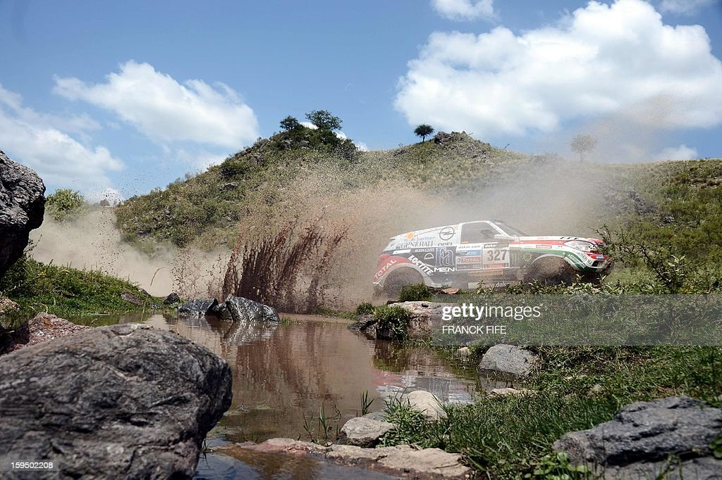 Opel's Balazs Szalay of Hungary competes during the Stage 9 of the Dakar 2013 between Tucuman and Cordoba, Argentina, on January 14, 2013. The rally will take place in Peru, Argentina and Chile January 5-20. AFP PHOTO / FRANCK FIFE