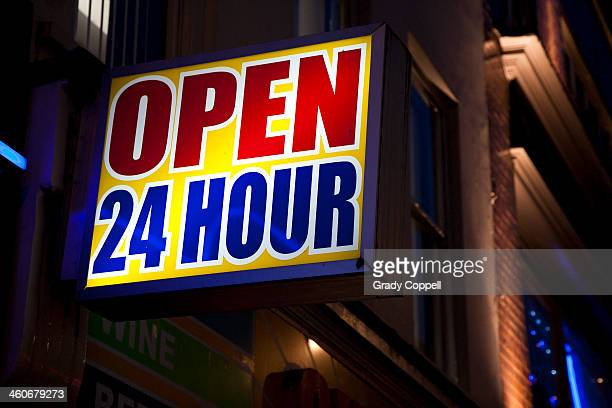Open 24 hour sign on city street