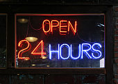 Open 24 Hours neon sign on a restaurant.