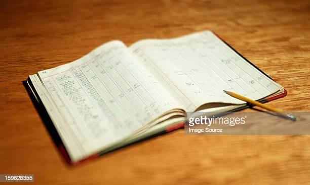 Open account book on wooden desktop