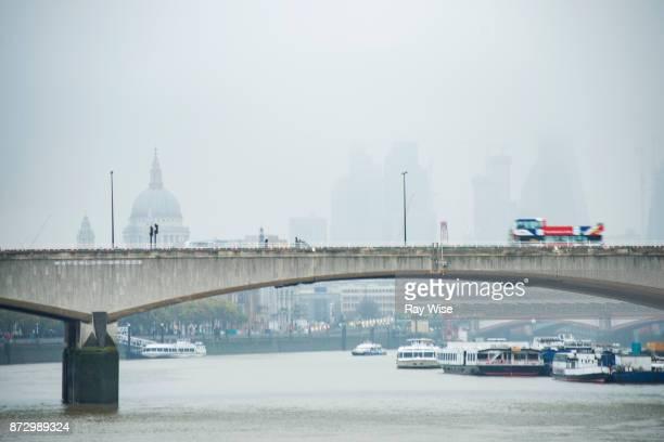 Open Air Bus on Waterloo Bridge in the rain.