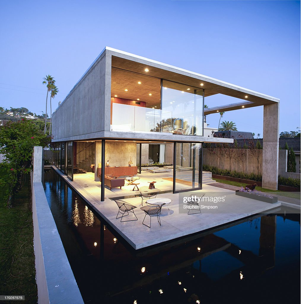 open, airy, Modernist home after sunset : Stock Photo