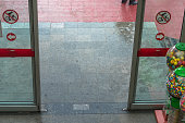 Open automatic door at the entrance of a shopping mall