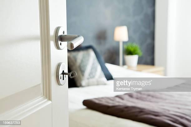 Open bedroom door with key