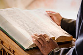 Open Bible on Church Altar With Preacher's Hands
