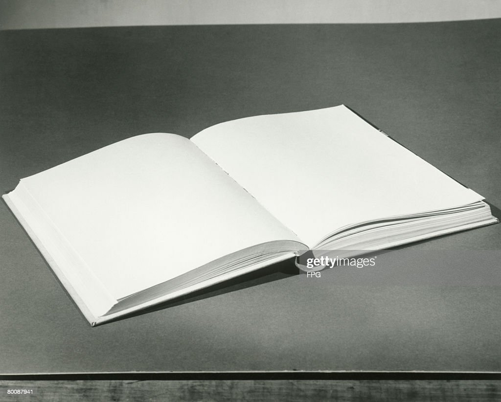 Open blank book on table : Stock Photo