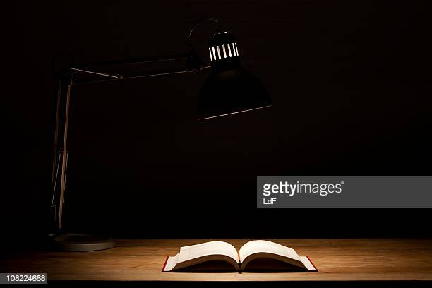 Open Book by Lamp Light