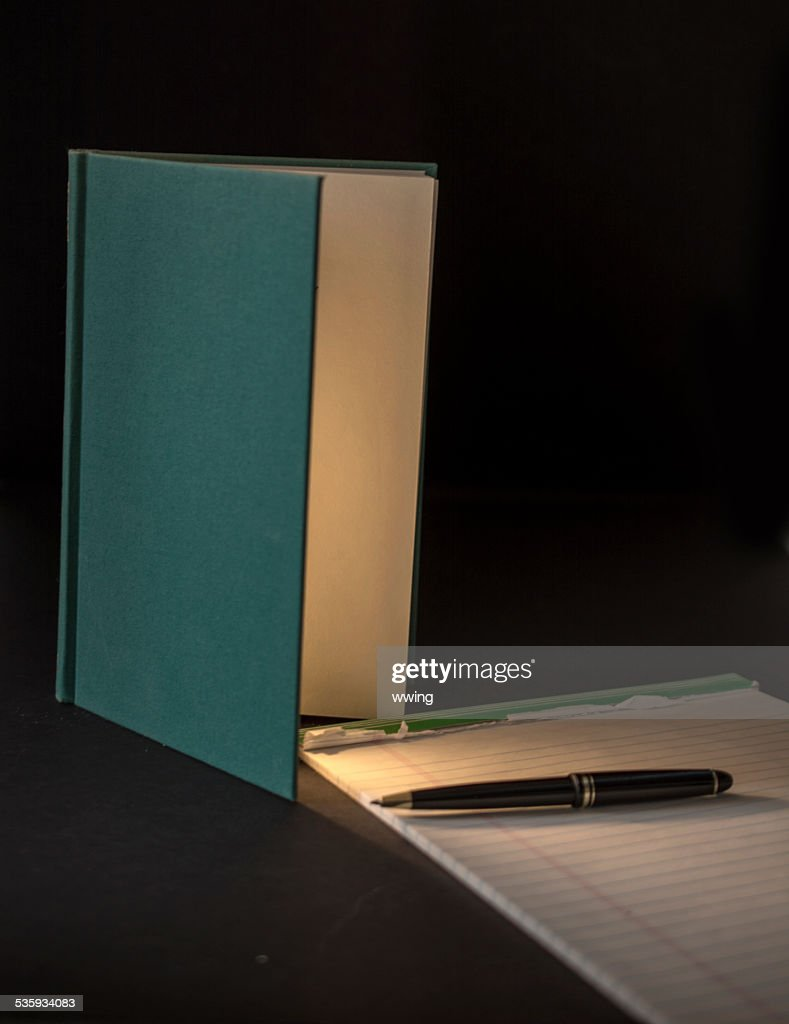 Open Book Illuminating Paper with copy space : Stock Photo