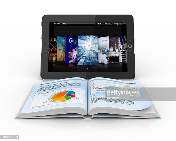 Open book in front of digital tablet
