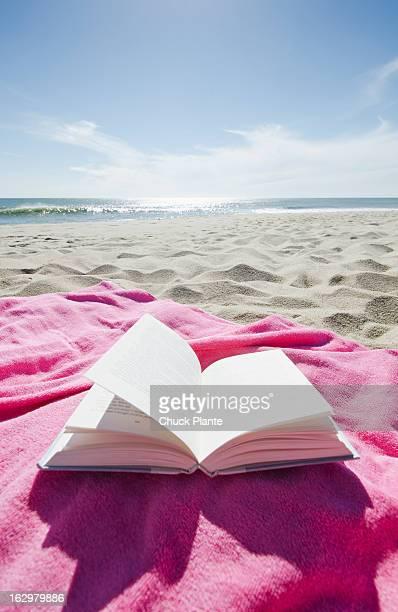 Open book on beach