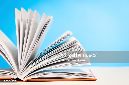 Open book on table, blue background