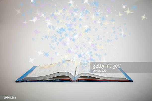 Open book sparkling, digital composite
