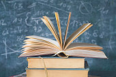 open book with black board, education and learning concept