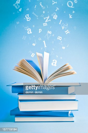 open book with flying scattered letters isolated on blue