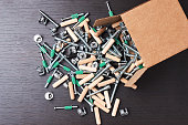Open box with fall out tools for furniture assembly, closeup