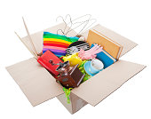Box of used items ready for a garage sale, auction, or donation to a charitable organization.  Shot on white Background.