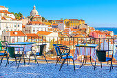 Open café tarrace with breathtaking view at Alfama - historical city-center of Lisbon, Portugal